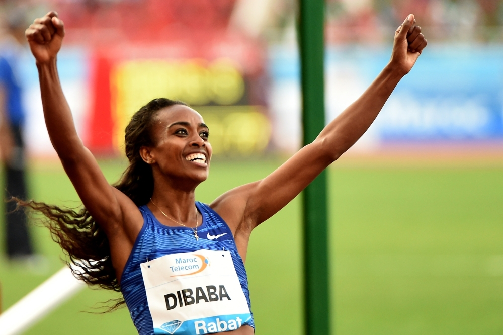 Ethiopia's Genzebe Dibaba celebrates after winning the women's 1,500m during the IAAF Diamond League competition on on Sunday in Rabat. — AFP