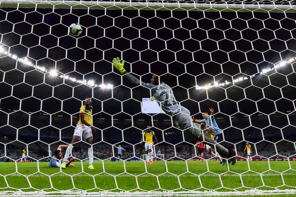 Uruguay's Luis Suarez (R) celebrates after an own goal by Ecuador's Arturo Mina (covered) during their Copa America football tournament group match at the Mineirao Stadium in Belo Horizonte, Brazil, on Sunday. — AFP