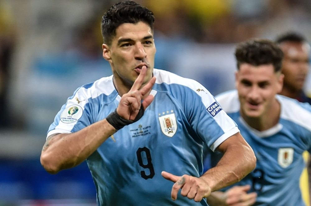 Uruguay's Luis Suarez celebrates after scoring against Ecuador during their Copa America football tournament group match at the Mineirao Stadium in Belo Horizonte, Brazil, on on Sunday. — AFP