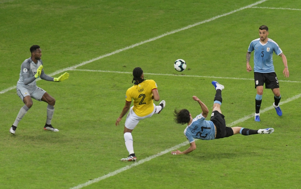 Uruguay's Edinson Cavani scores their second goal against Ecuador during their Copa America football tournament group match at the Mineirao Stadium in Belo Horizonte, Brazil, on on Sunday. — Reuters