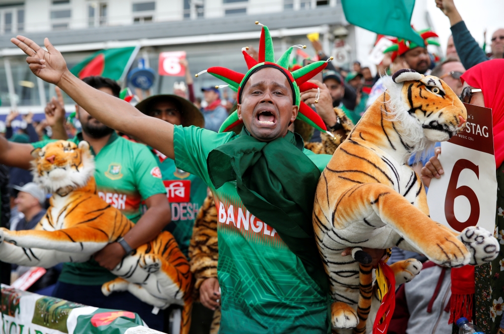 A Bangladesh fan celebrates during the ICC Cricket World Cup match against West Indies at The County Ground, Taunton, Britain, on Monday. — Reuters