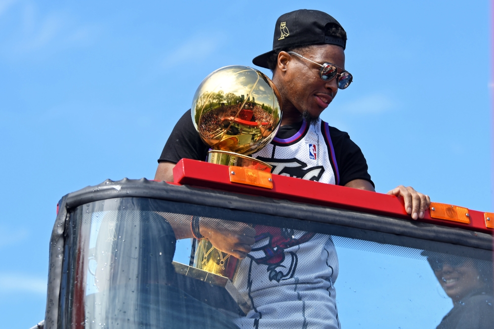 Toronto Raptor guard Kyle Lowry holds the Larry O'Brian trophy during the Toronto Raptors Championship Parade on Lakeshore Boulevard on Monday. — Reuters