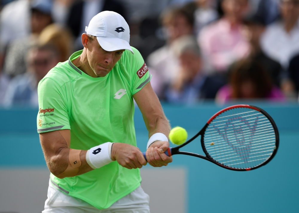 South Africa's Kevin Anderson in action during his first round match against Britain's Cameron Norrie in the ATP 500 Fever-Tree Championships at The Queen's Club, London, Britain, on Monday. — Reuters