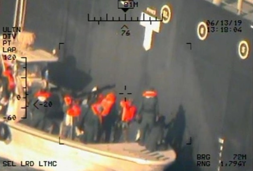 A US military image released by the Pentagon in Washington on Monday which it says was taken from a US Navy MH-60R helicopter in the Gulf of Oman in waters between Gulf Arab states and Iran on June 13, shows personnel that the Pentagon says are members of the Revolutionary Guard Corps Navy removing an unexploded limpet mine from the M/T Kokuka Courageous, a Japanese owned commercial motor tanker. — Reuters