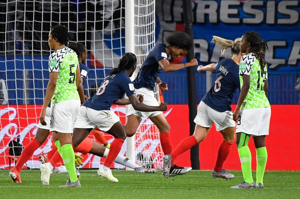 France's defender Wendie Renard (C) celebrates after scoring a penalty kick during the France 2019 Women's World Cup Group A football match between Nigeria and France, on Monday, at the Roazhon Park stadium in Rennes, western France. — AFP