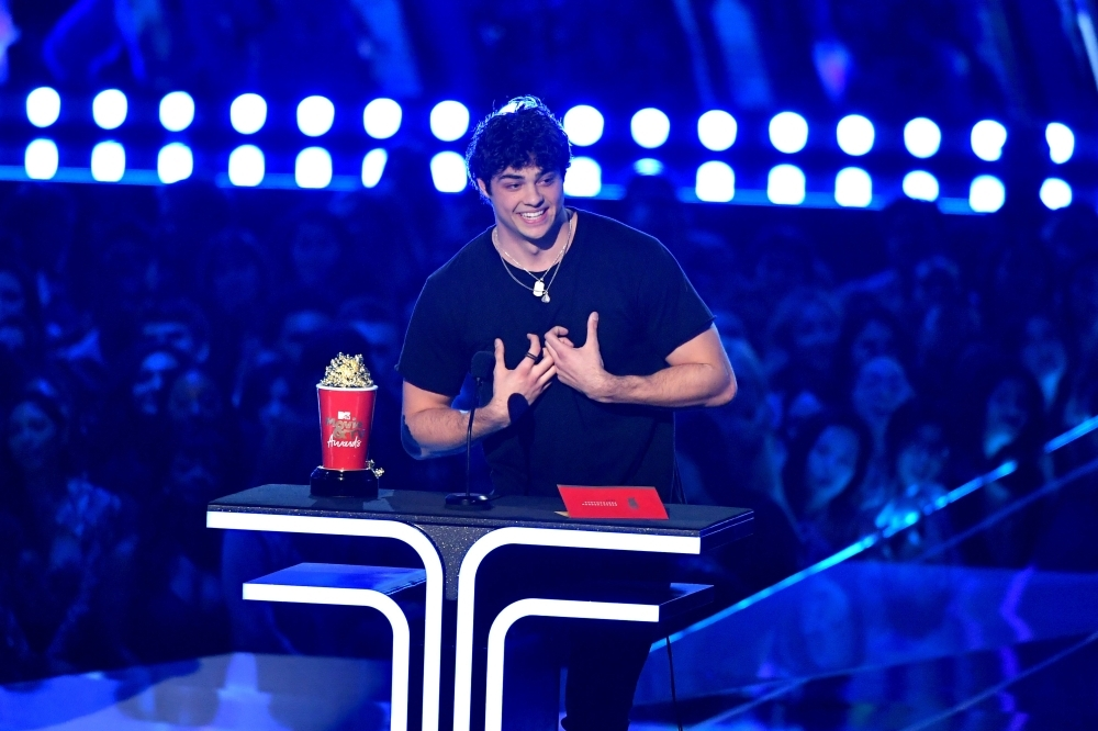 Noah Centineo accepts the Best Breakthrough Performance award for 'To All the Boys I've Loved Before' onstage during the 2019 MTV Movie and TV Awards at Barker Hangar in Santa Monica, California. — AFP
