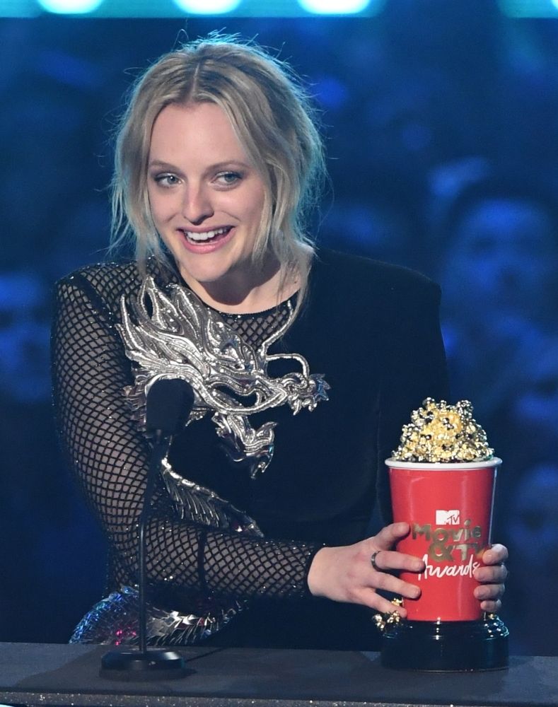 US actress Elisabeth Moss accepts the award for Best Performance in a Show for