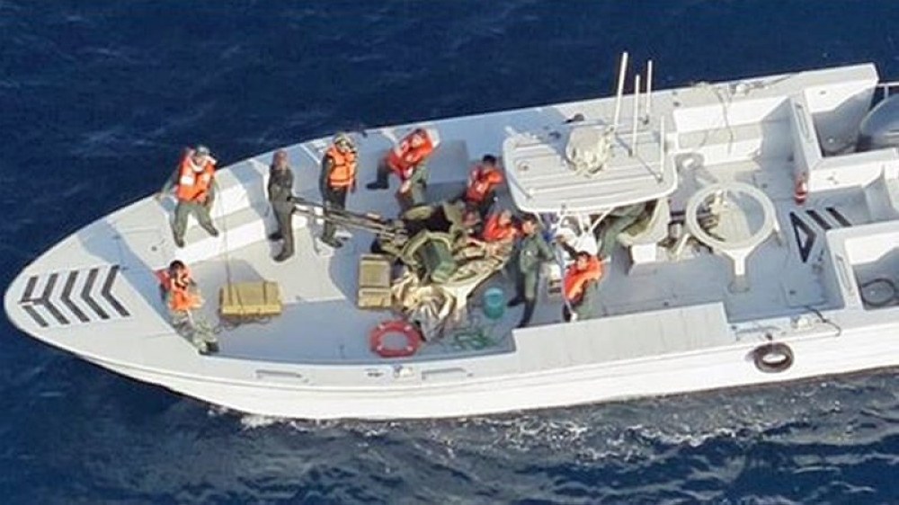 A handout photo made available by the US Department of Defense (DoD) on Monday shows an Iranian patrol boat armed with a Russian-made ZU-23-2, a twin-barreled anti-aircraft cannon, after reportedly removing an