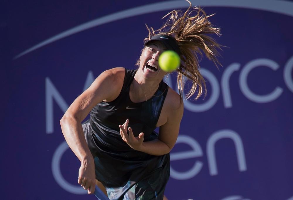 Russia's Maria Sharapova returns the ball to Slovakia's Viktoria Kuzmova during their women's singles match of the Mallorca Open tennis tournament in Santa Ponca on Tuesday. — AFP