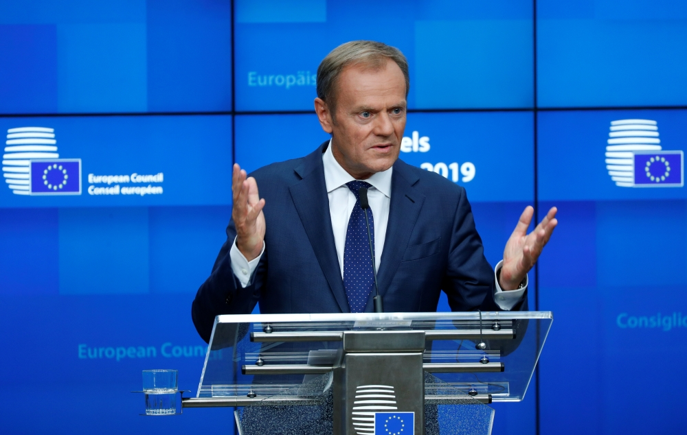 European Council President Donald Tusk talks during a news conference after the European Union leaders summit in Brussels, Belgium, on Friday. — Reuters