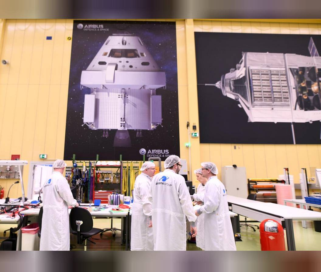 Employees chat at a production line of Airbus' European Service Module (ESM), which is delivered for NASA's Orion Spaceship, at the Airbus plant in Bremen, Germany. — Reuters