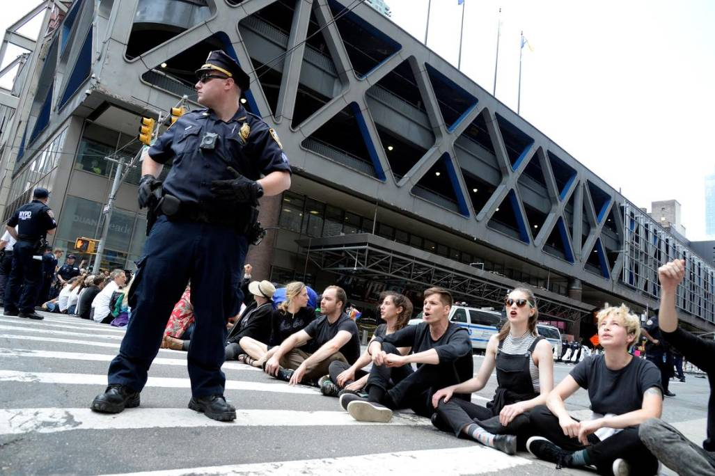 Activists from the group Extinction Rebellion block traffic on 8th Avenue in front of the New York Times building and the Port Authority Bus Terminal near Times Square in the Manhattan borough of New York City, Sunday. - Reuters