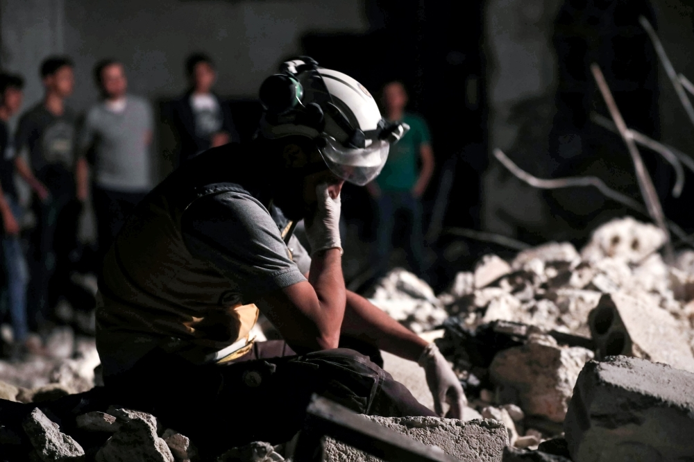 A member of the Syrian Civil Defense, also known as the