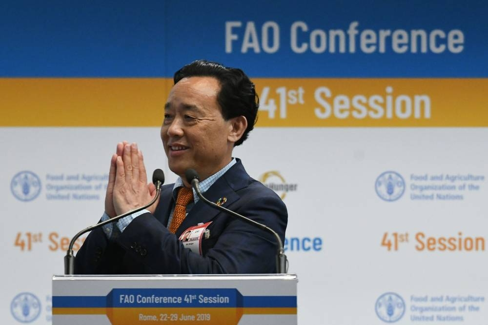 Newly-appointed FAO Director-General, China's Qu Dongyu acknowledges applause on June 23, 2019 following the delegates' vote during the FAO 41st Conference at the Food and Agriculture Organization of the United Nations (FAO) headquarters in Rome.  / AFP / Vincenzo PINTO
