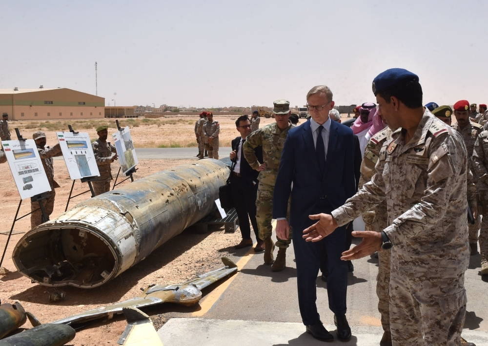 Brian Hook (2nd R), the US special representative on Iran, checks Iranian-made Houthi missiles and drones intercepted over Saudi territory and the remnants of a