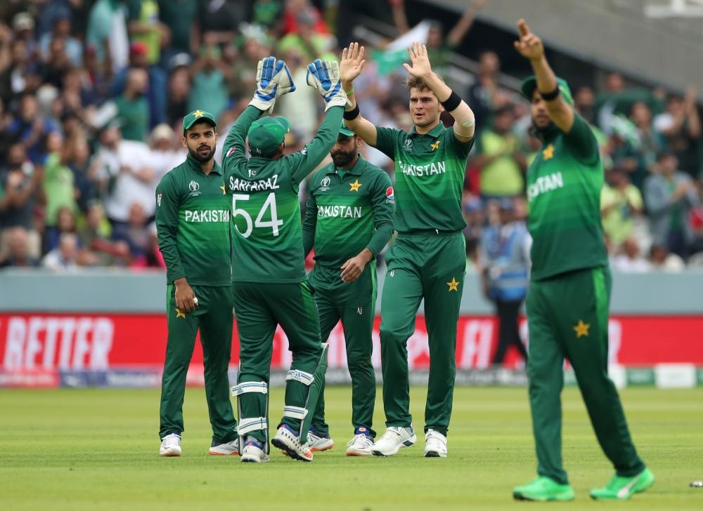 Pakistan's Shaheen Afridi celebrates taking the wicket of South Africa's David Miller with teammates during the     ICC Cricket World Cup match at the Lord's Cricket Ground, London, Britain, on Sunday. — Reuters