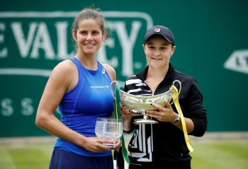 Australia's Ashleigh Barty and Germany's Julia Goerges pose with their trophies after Barty won the women's singles final tennis match at the WTA Nature Valley Classic tournament at Edgbaston Priory Club in Birmingham, central England on Sunday. — Reuters