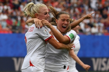 England's defender Alex Greenwood (L) is congratulated by teammates after scoring a goal during the France 2019 Women's World Cup round of sixteen football match between England and Cameroon, on Sunday, at the Hainaut stadium in Valenciennes, northern France. — AFP