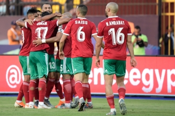 Morocco's players celebrate their goal during the 2019 Africa Cup of Nations (CAN) football match between Morocco and Namibia at the Al Salam Stadium in Cairo on Sunday.  — AFP