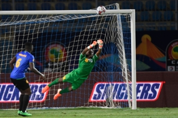 Tanzania's goalkeeper Aishi Manula punches the ball away during the 2019 Africa Cup of Nations (CAN) football match against Senegal at the 30 June Stadium in Cairo on Sunday.  — AFP