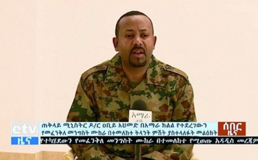 In this handout videograb released by the Ethiopian TV broadcast, Ethiopia's Prime Minister Abiy Ahmed addresses the public on television on Sunday after a failed coup.  - AFP