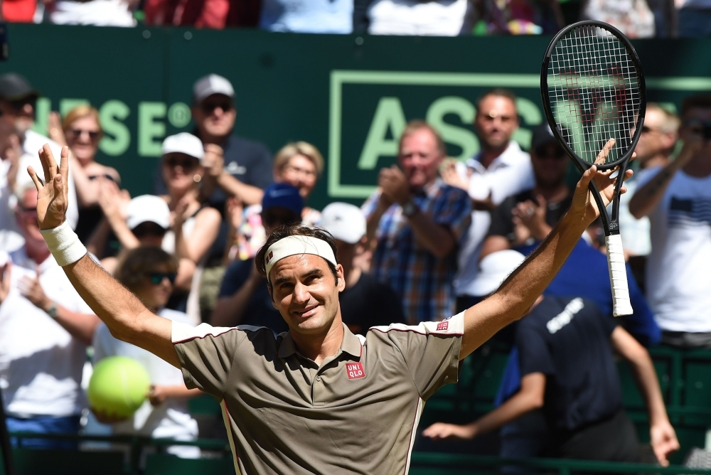 Roger Federer from Switzerland reacts after he won his final match against David Goffin from Belgium at the ATP tennis tournament in Halle, western Germany, on Sunday. — AFP
