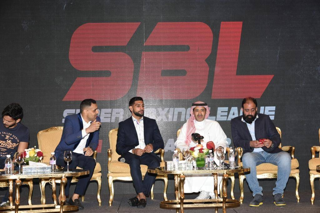 British-Pakistani boxer Amir Khan (3rd right) at a press conference in Jeddah on Monday.