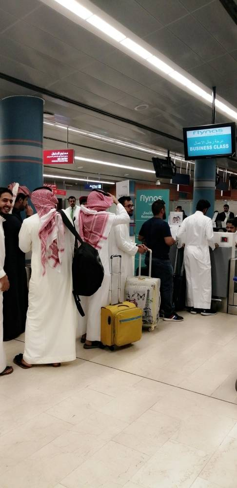 Passengers waiting at the check-in counter at Abha airport which is operating normally Monday, a day after a Houthi attack in which a Syrian national was killed and 21 others were injured. — Okaz photo