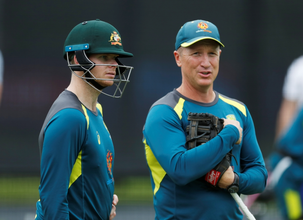 Australia's Steve Smith and wicket keeping coach Brad Haddin during ICC Cricket World Cup  nets at the Lord's Cricket Ground, London, Britain, on Monday. — Reuters