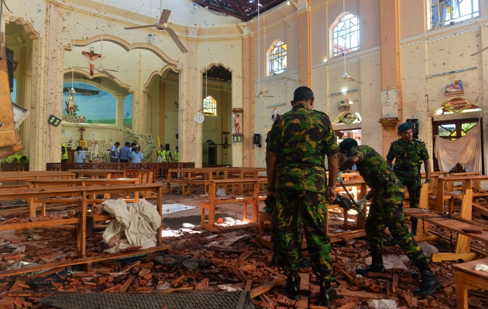 Security personnel inspect the interior of St. Sebastian's Church in Negombo, a day after the church was hit in series of bomb blasts targeting churches and luxury hotels in Sri Lanka, in this April 23, 2019 file photo. — AFP