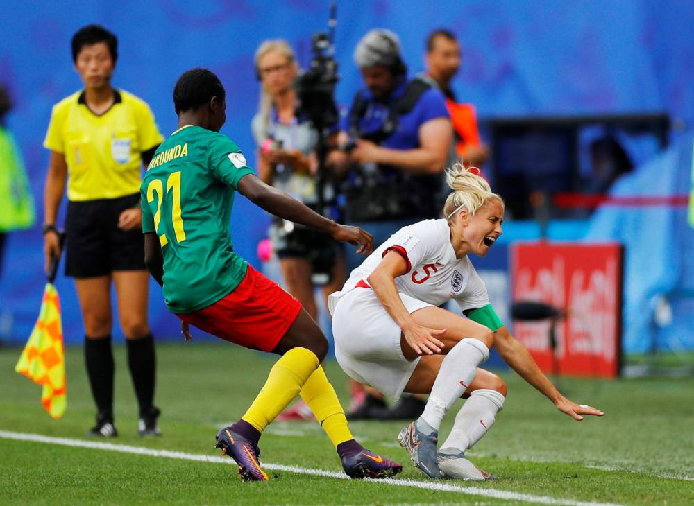 England's Steph Houghton reacts after being fouled by Cameroon's Alexandra Takounda during the Women's World Cup round of 16 match at the Stade du Hainaut, Valenciennes, France on Sunday. — Reuters