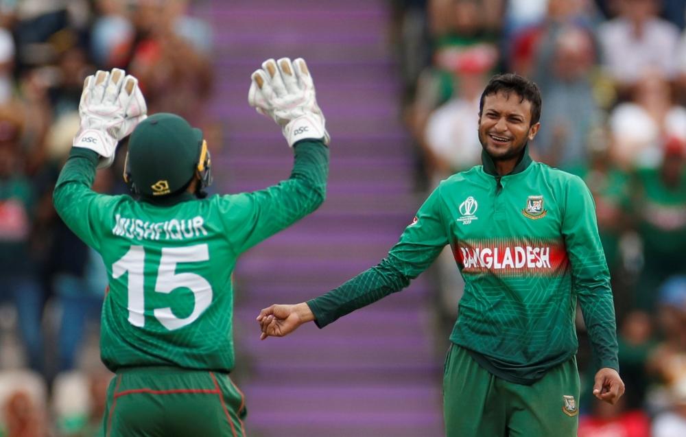 Bangladesh's Shakib Al Hasan and Mushfiqur Rahim celebrate taking the wicket of Afghanistan's Najibullah Zadran during the ICC Cricket World Cup match at The Ageas Bowl, Southampton, Britain on Monday. —Reuters