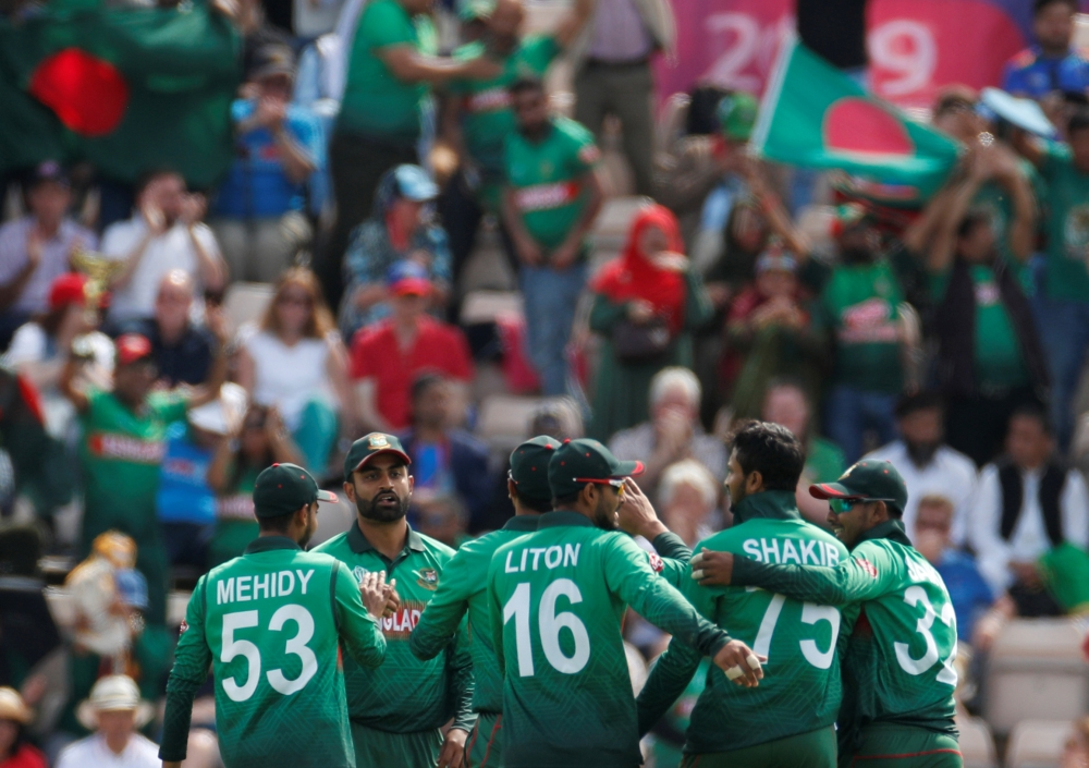 Bangladesh's Shakib Al Hasan celebrates with teammates after taking the wicket of Afghanistan's Rahmat Shah during the ICC Cricket World Cup match at The Ageas Bowl, Southampton, Britain on Monday. — Reuters