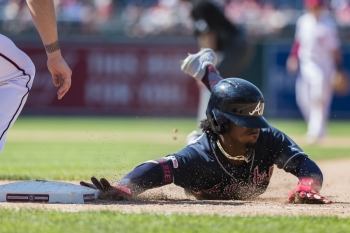 Ozzie Albies No. 1 of the Atlanta Braves beats the throw to first against the Washington Nationals during the tenth inning at Nationals Park on Sunday in Washington, DC. — AFP