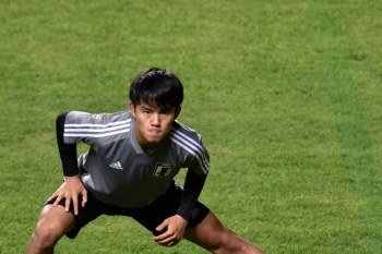 Japan's Takefusa Kubo stretches during a training session of the national team at the Independencia stadium, in Belo Horizonte, Brazil, on Friday, during the Copa America football tournament. — AFP