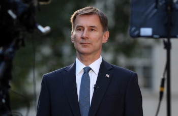 Conservative Party leadership candidate Jeremy Hunt attends an interview outside his home in London on Monday. — Reuters