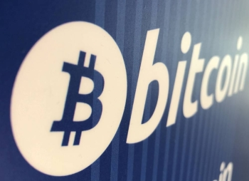 FILE PHOTO: A Bitcoin logo is seen on a cryptocurrency ATM in Santa Monica, California, U.S., January 4, 2018. REUTERS/Lucy Nicholson/File Photo