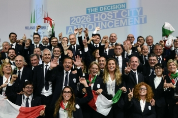 Members of the delegation of Milan/Cortina d'Ampezzo 2026 Winter Olympics candidate city react after the city was elected to host the 2026 Olympic Winter Games during the 134th session of the International Olympic Committee (IOC), in Lausanne on Monday. — AFP