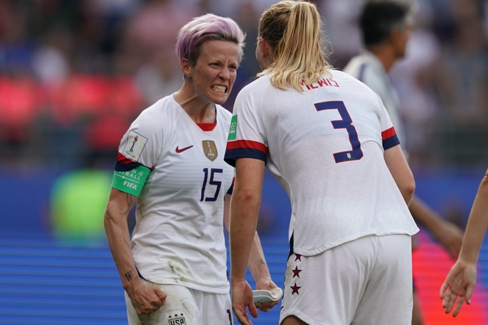 United States' forward Megan Rapinoe (L) and United States' midfielder Sam Mewis celebrate at the end of the France 2019 Women's World Cup round of sixteen football match against Spain on Monday, at the Auguste-Delaune stadium in Reims, northern France. — AFP