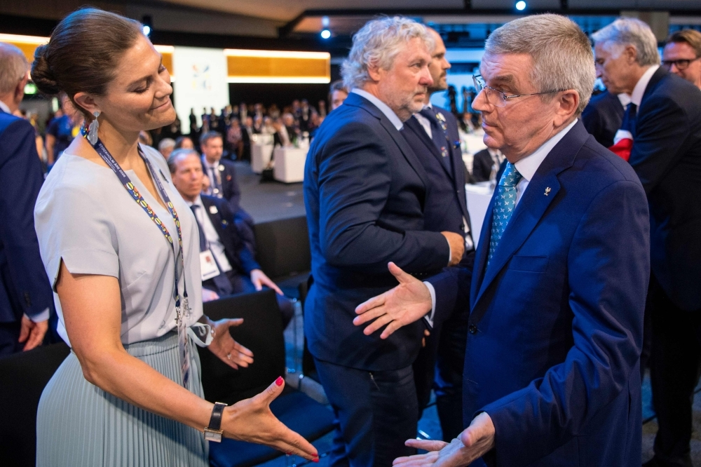 Member of the delegation from Stockholm/Are 2026 Winter Olympics, Sweden's Crown Princess Victoria (L) and International Olympic Committee (IOC) president Thomas Bach react after Stockholm/Are was not elected to host the 2026 Olympic Winter Games during the 134th session of the International Olwasympic Committee (IOC), in Lausanne on Monday. — AFP