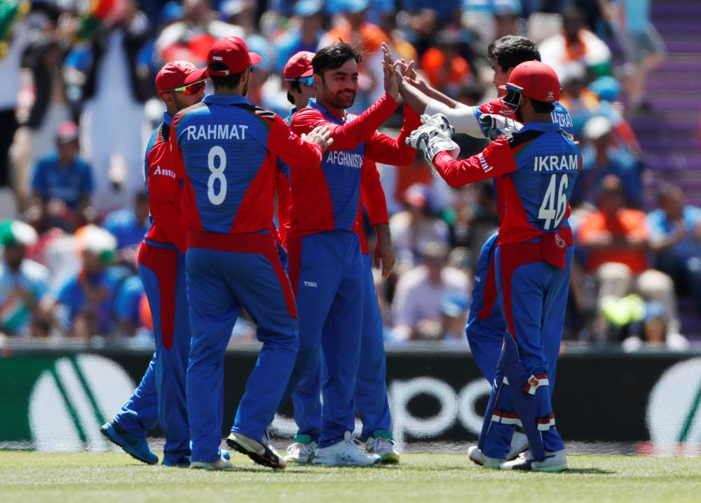 Afghanistan's Rashid Khan celebrates taking the wicket of India's MS Dhoni during the ICC Cricket World Cup match at The Ageas Bowl, Southampton, Britain, on Saturday. —  Reuters