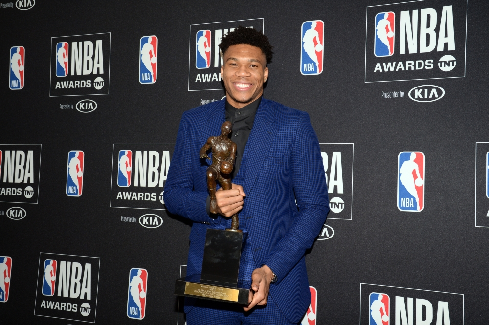 Milwaukee Bucks forward Giannis Antetokounmpo poses with his NBA most valuable player at the 2019 NBA Awards show at Barker Hanger. — Reuters