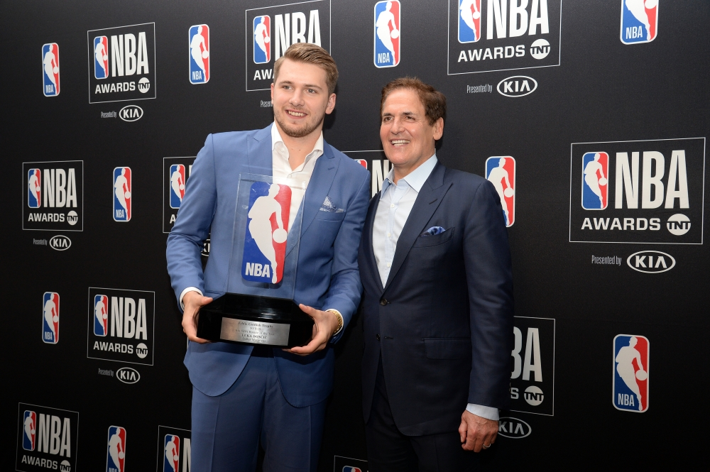 Dallas Mavericks guard Luka Doncic poses with owner Mark Cuban following his award for Rookie Of The Year at the 2019 NBA Awards show at Barker Hanger. — Reuters