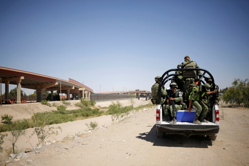 Members of Mexico's National Guard patrol the border between Mexico and the US as part of an ongoing operation to prevent migrants from crossing illegally into the United States, in Ciudad Juarez, Mexico, on Monday. — Reuters