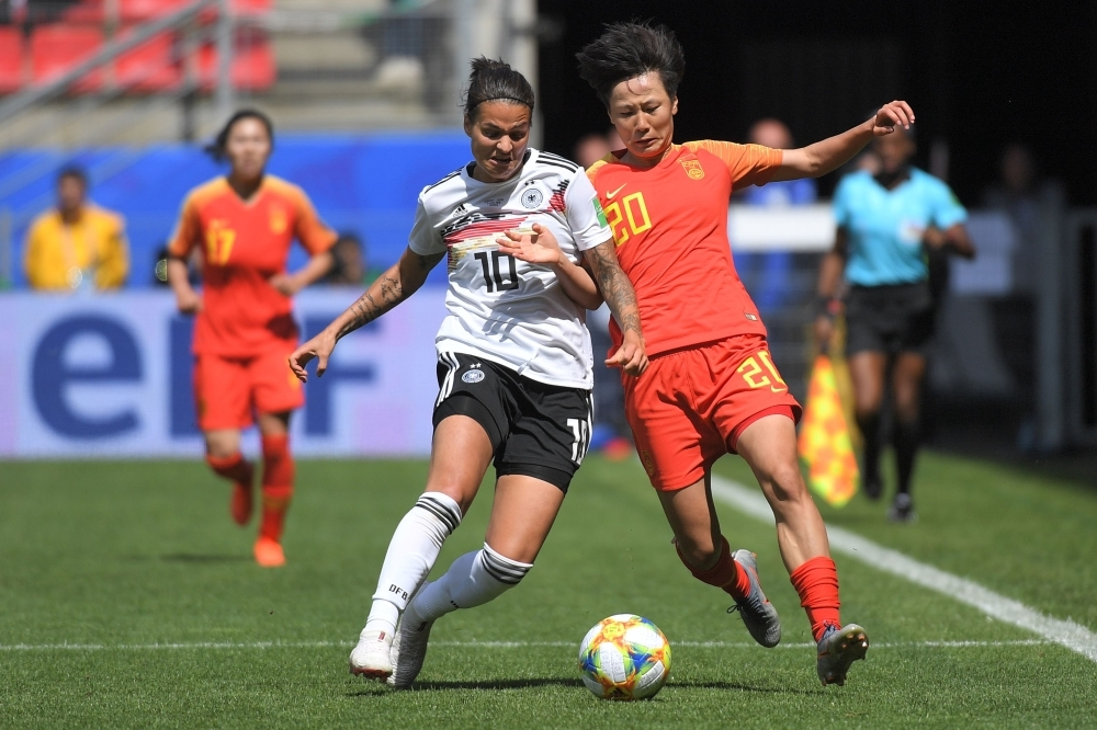 In this file photo taken on June 8, 2019, Germany's midfielder Dzsenifer Marozsan (L) vies for the ball with China's midfielder Rui Zhang during the France 2019 Women's World Cup Group B football match at the Roazhon Park stadium in Rennes, western France. Germany and Olympique Lyon star Dzsenifer Marozsan is set to make a return to World Cup action in the last-eight clash with Sweden after missing three games with a broken toe, coach Martina Voss-Tecklenburg said on Tuesday. — AFP