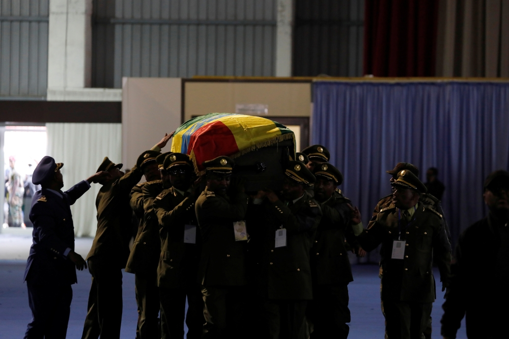 Ethiopian army generals carry the coffin of general Gezai Abera, who was shot by a bodyguard, during a memorial ceremony in Addis Ababa, Ethiopia, on Tuesday. — Reuters