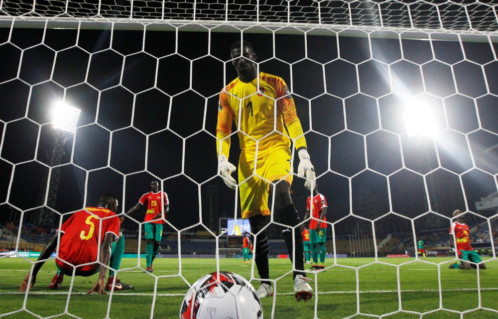 Guinea-Bissau's Jonas Mendes reacts after conceding a goal during the 2019 Africa Cup of Nations (CAN) football match against Caneroon at the Ismailia Stadium on Tuesday. — Reuters
