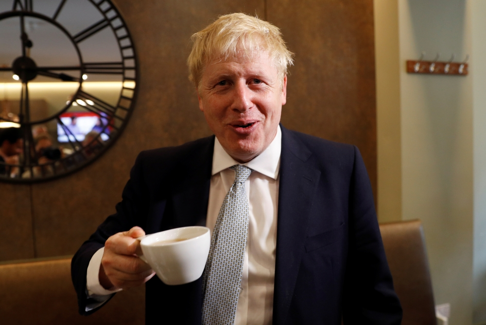 Boris Johnson, a leadership candidate for Britain's Conservative Party, visits a tea shop in Oxshott, Surrey, Britain, on Tuesday. — Reuters