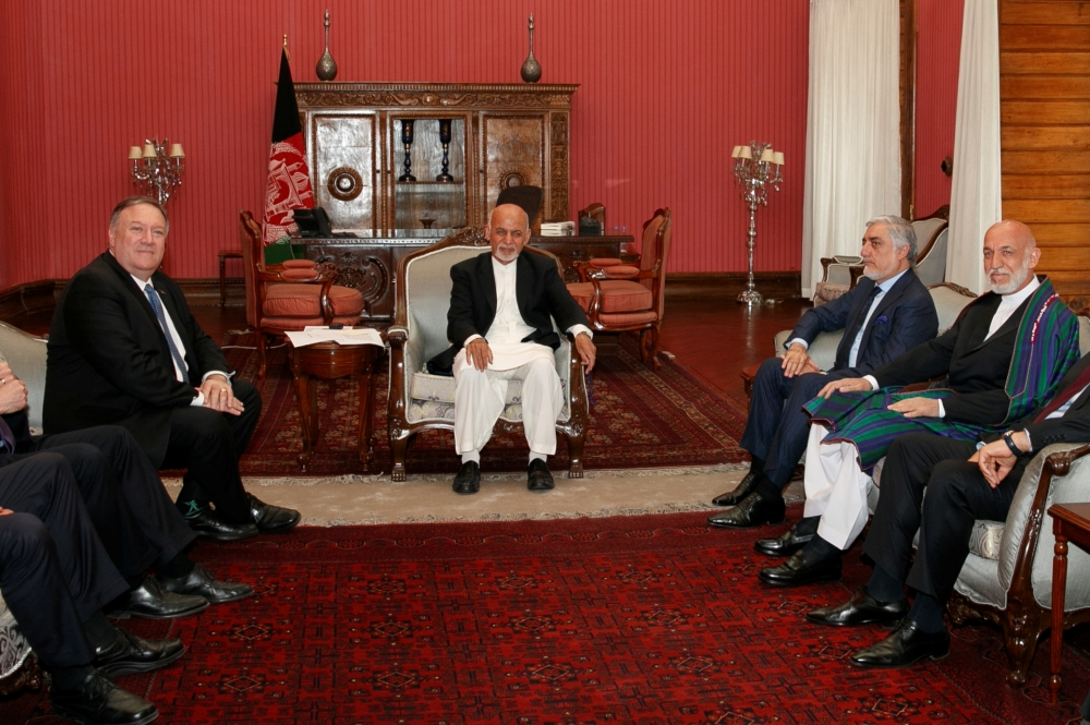 Secretary of State Mike Pompeo meets with Afghan President Ashraf Ghani, Afghan Chief Executive Officer Abdullah Abdullah, and former Afghan President Hamid Karzai at the Presidential Palace in Kabul on Tuesday. — Reuters