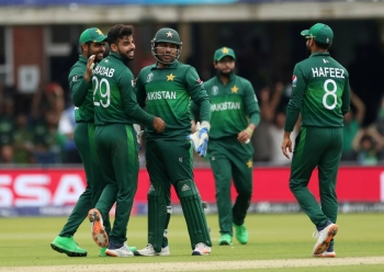 Pakistan's Shadab Khan celebrates taking the wicket of South Africa's Aiden Markram with teammates during the ICC Cricket World Cup match at Lord's Cricket Ground, London, Britain on Sunday. — Reuters